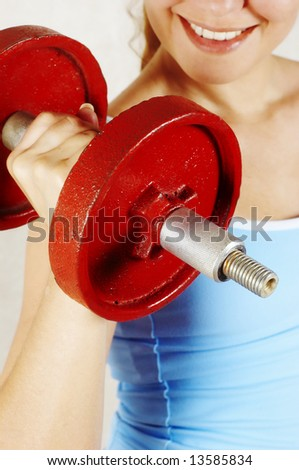 beautiful girl and red dumbbell - stock photo