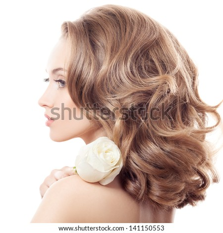Beautiful Girl And Rose. Healthy Long Curly Hair. - stock photo