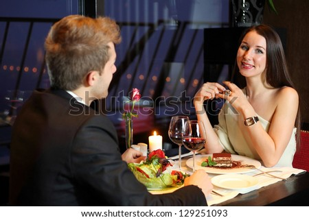 Beautiful girl and young boy met at a restaurant for dinner - stock photo