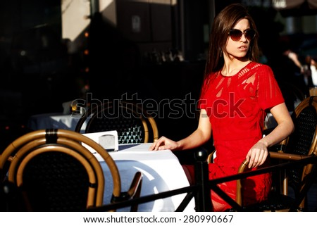 Beautiful girl at the table - stock photo