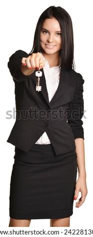 Beautiful girl broker holding sale house key. white background - stock photo