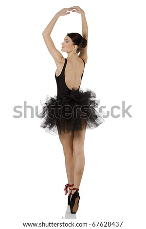 beautiful girl classic dancer with black dress and shoes on white background dancing in point - stock photo