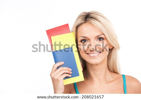 beautiful girl closeup portrait and smiling. young girl holding tickets on white background - stock photo