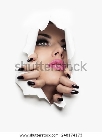 beautiful girl coming out of a white background - stock photo