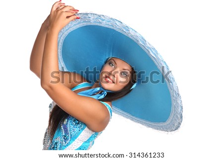 beautiful girl dancing in blue hat .  flirty look. Game emotions. - stock photo