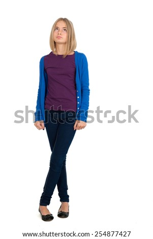 Beautiful girl doing different expressions in different sets of clothes: full length posing - stock photo