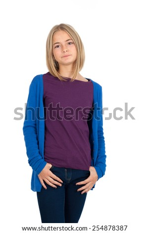 Beautiful girl doing different expressions in different sets of clothes: hands in pockets - stock photo