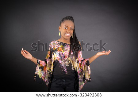 Beautiful girl doing different expressions in different sets of clothes: joy - stock photo