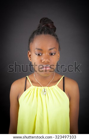 Beautiful girl doing different expressions in different sets of clothes: sad - stock photo