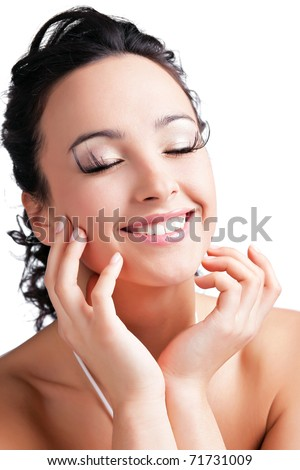 beautiful girl doing facial massage - stock photo