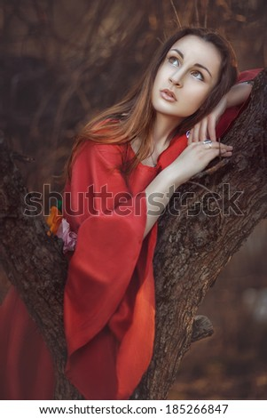Beautiful girl dreaming under a tree missing. - stock photo