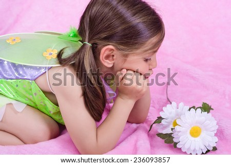 beautiful girl dressed as fairy - stock photo