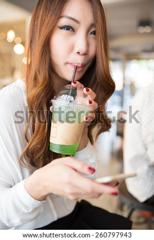 Beautiful girl drinking water in the cafe - stock photo