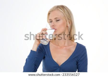beautiful girl drinks glass of water - stock photo