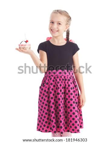 Beautiful girl eating a cake - stock photo