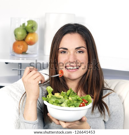 beautiful girl eating healthy food - stock photo