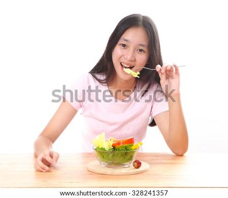 Beautiful girl eating healthy salad food - stock photo