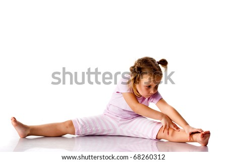 Beautiful girl exercising, stretching isolated on white - stock photo