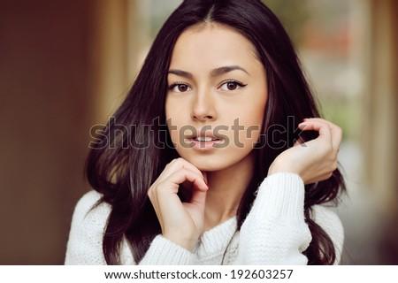 Beautiful girl face - outdoors   - stock photo