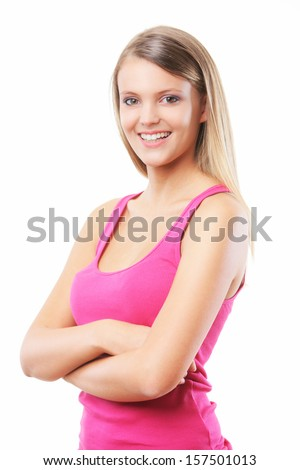 Beautiful girl folding her arms, smiling on a white background  - stock photo