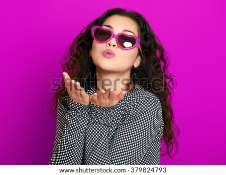 beautiful girl glamour portrait on magenta make flying kiss - stock photo
