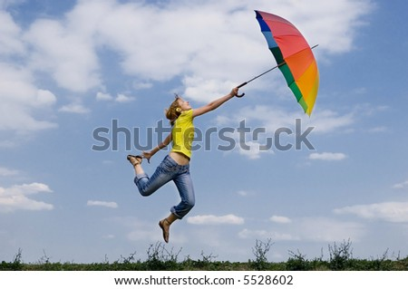 Beautiful girl has been carried off by the wind - stock photo