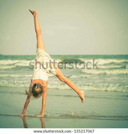 Beautiful girl having fun at beach - stock photo