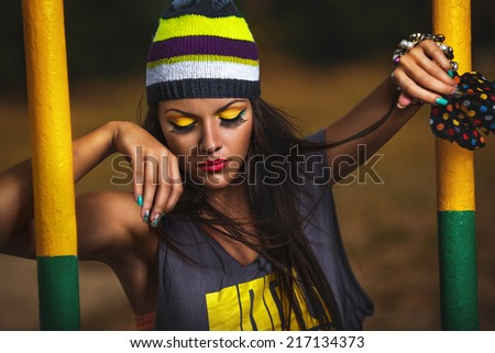 Beautiful girl hipster in the morning on sports ground - stock photo