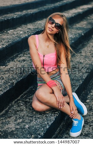 beautiful girl hipster posing on the steps   - stock photo