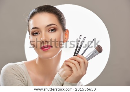 beautiful girl holding a brush - stock photo