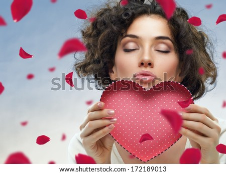 beautiful girl holding a heart - stock photo