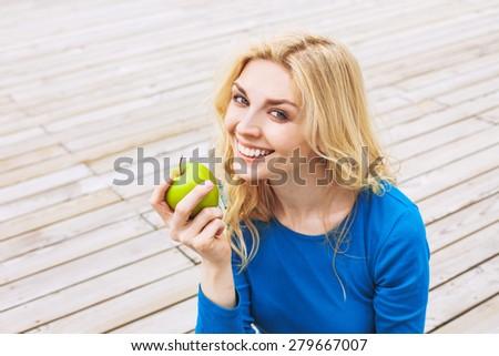 Beautiful girl holding apple - stock photo