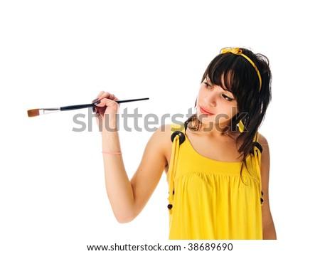 beautiful girl holding painting brush isolated on white - stock photo