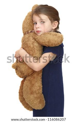 Beautiful girl hugging a teddy bear - stock photo