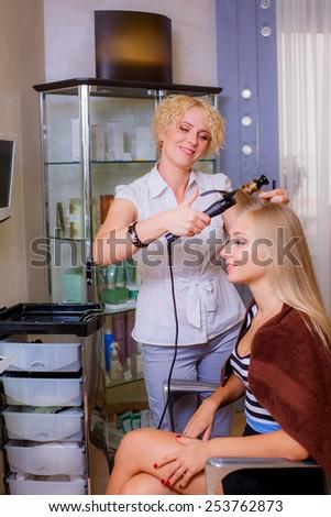 beautiful girl in a beauty salon, hair care - stock photo