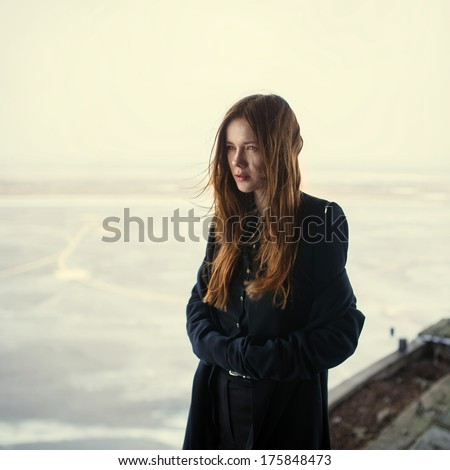 beautiful girl in a black coat. photo Gothic - stock photo