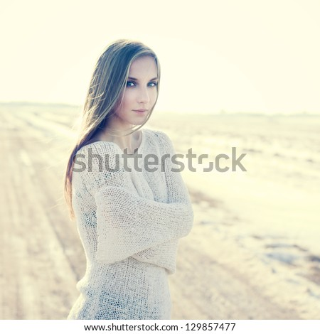 Beautiful girl in a bright sunny day - stock photo