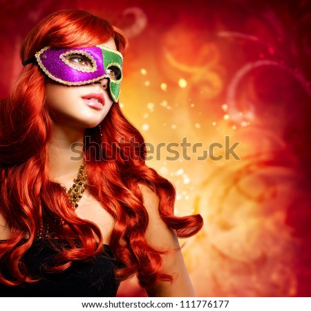 Beautiful Girl in a Carnival mask. Masquerade - stock photo