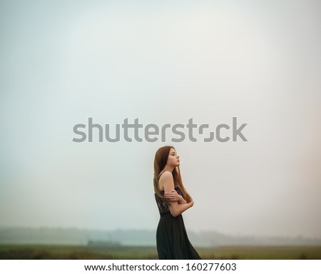 beautiful girl in a dress in the cold - stock photo