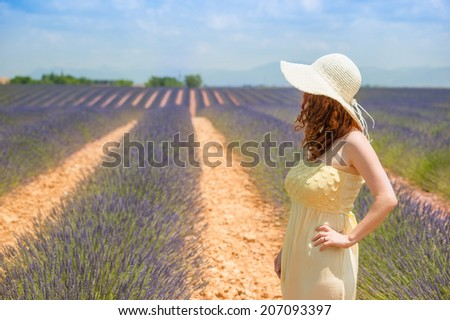 Beautiful girl in a lavender field, Provence, France - stock photo