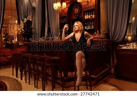 Beautiful girl in a luxury bar - stock photo