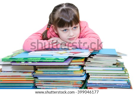 Beautiful girl in a pink jacket lies in thought on a pile of books - stock photo