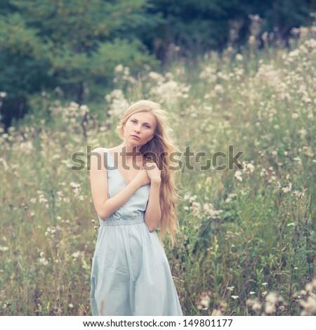 beautiful girl in a summer field - stock photo