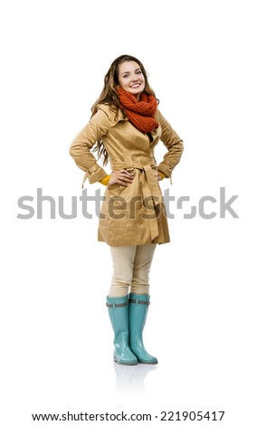 Beautiful girl in autumn clothes posing in studio, isolated on white background - stock photo