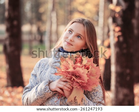 beautiful girl in autumn park - stock photo