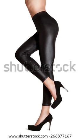 Beautiful girl in black tights and shoes. Isolated on white background - stock photo