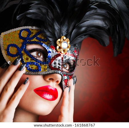 Beautiful girl in carnival mask - stock photo