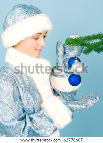 Beautiful girl in costume with new year toys - stock photo
