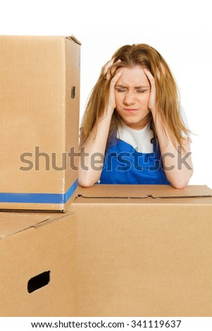beautiful girl in coverall has a stress with moving  - stock photo