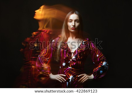 beautiful girl in dress. beauty sexy young woman on the light colored effects - stock photo